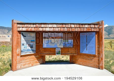 BRIGHAM CITY, UTAH - JUNE 28, 2017: Bear River Migratory Bird Refuge info kiosk. The refuge covers the Bear River and its delta where it flows into the northern part of the Great Salt Lake.