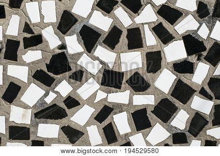 The Texture Of The Old Wall Is Decorated With Mosaic Slices Of C