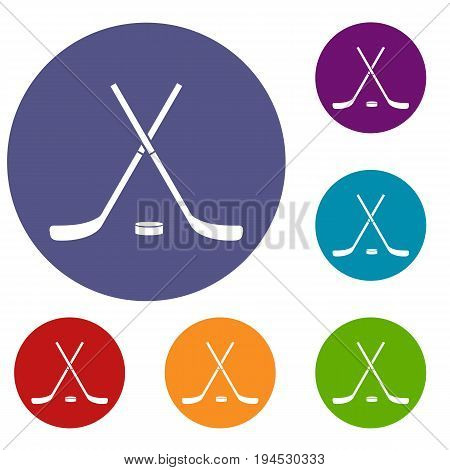 Crossed hockey sticks and puck icons set in flat circle reb, blue and green color for web