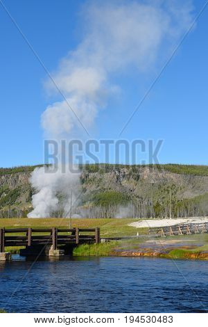 Bridge over the Firehole River at Midway Geyser Basin in Yellowstone National Park, Wyoming.