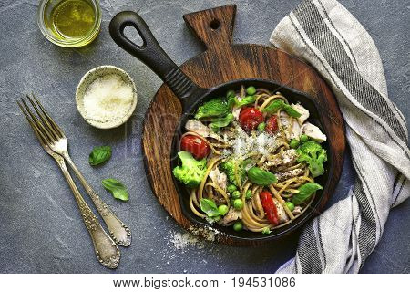 Whole Wheat Pasta With Chicken Fillet And Vegetables In A Cast Iron  Pan.top View.