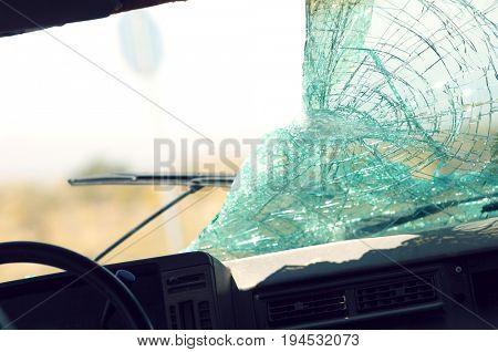 Broken car windshield, view from interior