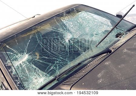 Close-up of car with broken windshield