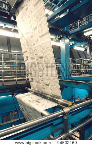 Closeup of newspaper production and printing process