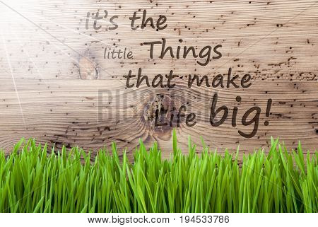 English Quote It Is The Little Things That Make Life Big. Spring Season Greeting Card. Bright, Sunny And Aged Wooden Background With Gras.