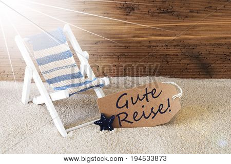 Sunny Summer Label With Sand And Aged Wooden Background. German Text Gute Reise Means Good Trip. Deck Chair For Holiday Or Vacation Feeling.