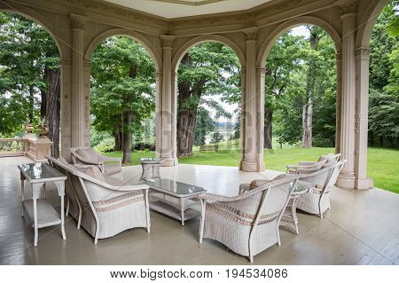 RED HOOK, NY, USA - JULY 3,2017: MONTGOMERY PLACE ESTATE. A historic landmark in Dutchess County, NY. Shown here is the porch on the north side of the main house.