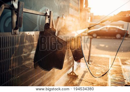 Car carpets washing with high pressure washer