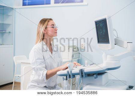 Ultrasound machine, doctor's hand usg investigation USCG.