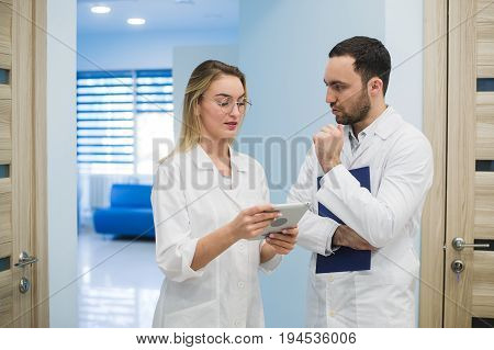 Male doctor with ultrasonic equipment during ultrasound medical examination.