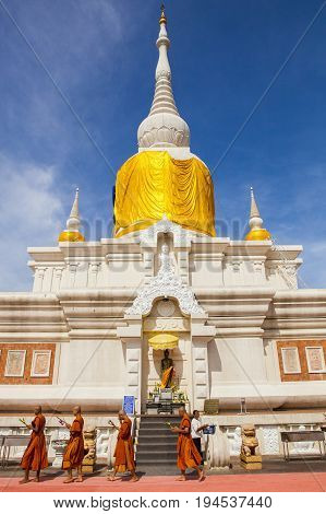 MAHASARAKHAM THAILAND - JULY82017 : thai buddha munk praying around Prathat Nadun pagoda most important buddhism place in Mahasarakham province north eastern of thailand