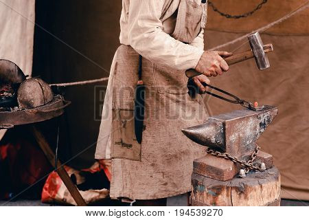 Blacksmiths work as forging forging on metal. The concept of making products from iron.