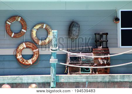 fisherman's porch with life floats and fishing crates