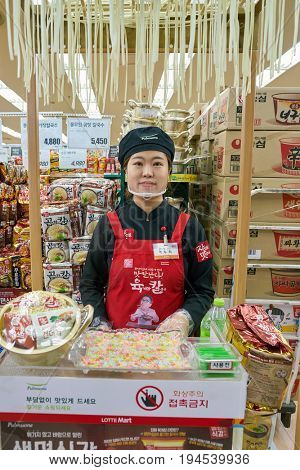 SEOUL, SOUTH KOREA - CIRCA MAY, 2017: indoor portrait of worker at Lotte Mart in Seoul.