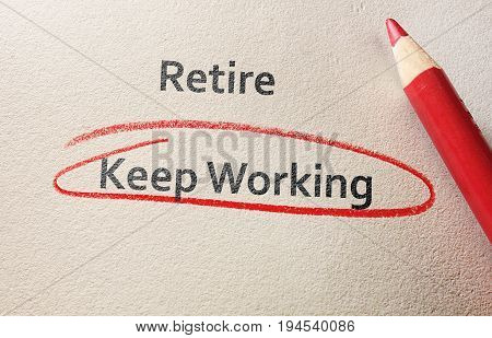 Keep Working circled in red below Retire text