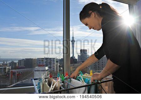 Young Woman Hangs The Washing