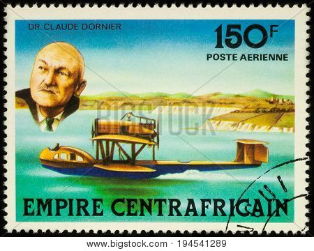 Moscow Russia - July 09 2017: A stamp printed in Central African Empire shows German inventor Claude Dornier and his hydroplane series