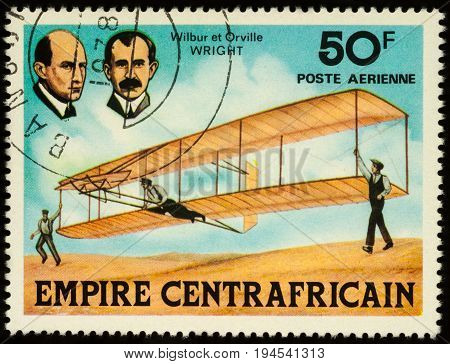 Moscow Russia - July 09 2017: A stamp printed in Central African Empire shows inventors of airplane brothers Wilbur and Orville Wright series