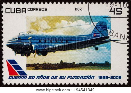 Moscow Russia - July 08 2017: A stamp printed in Cuba shows old aircraft Douglas DC-3 series