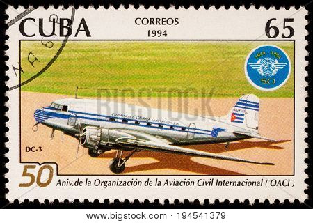 Moscow Russia - January 14 2017: A stamp printed in Cuba shows old passenger aircraft Douglas DC-3 and emblem of ICAO series