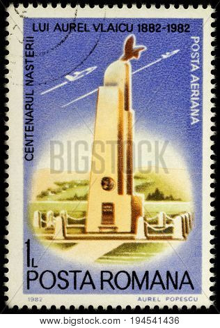 Moscow Russia - July 07 2017: A stamp printed in Romania shows monument to Aurel Vlaicu aviator series