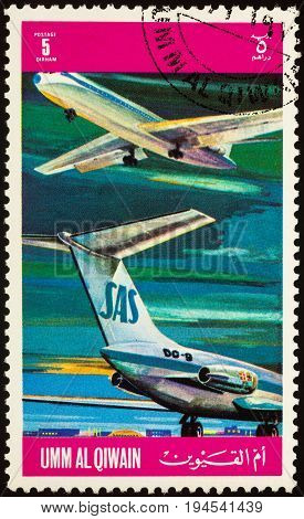 Moscow Russia - July 10 2017: A stamp printed in Umm al-Quwain shows passenger airliner Douglas DC-9 of SAS (Scandinavian Airlines System) series