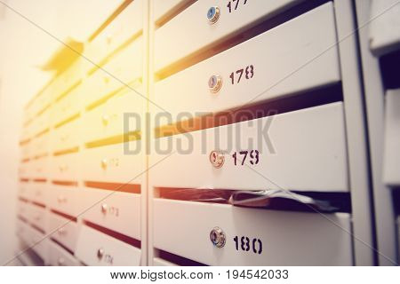 Mailboxes of apartment buildings lockable with newspapers leaflets brochures and letters. Conception of the correspondence of friends.