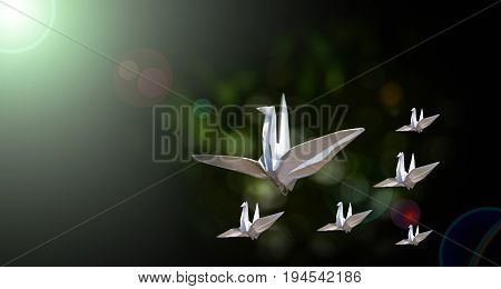 leading business concept vision of leader paper birds strive to goal of light with green bokeh and dark background