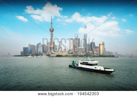 Police boat at Huangpu river Shanghai skyline with modern urban skyscrapers China