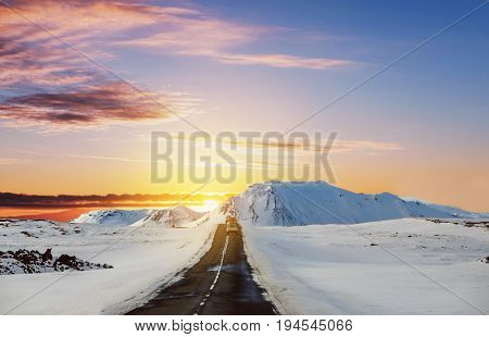Landscaped on the road in winter, road trip on the country road at Iceland in sunrise