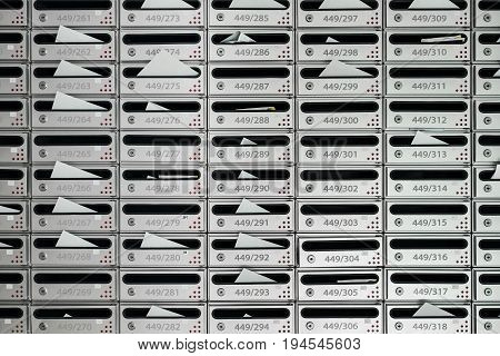 Letterboxes and bills with letters, with room number