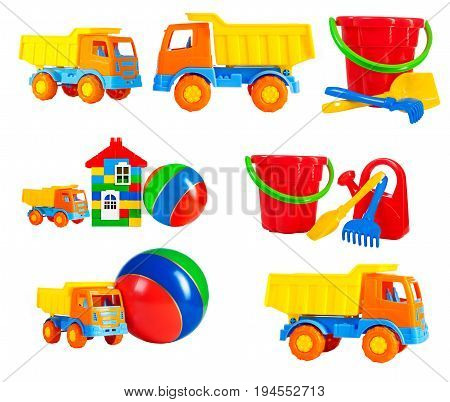 bright multi-colored toys for children isolated on a white background a set. toys - machine truck a ball a toy house a bucket a rake a shovel a watering can isolated on a white background