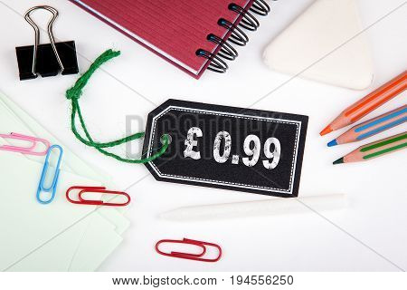 0.99 pound pence. Price tag with string on a white background.