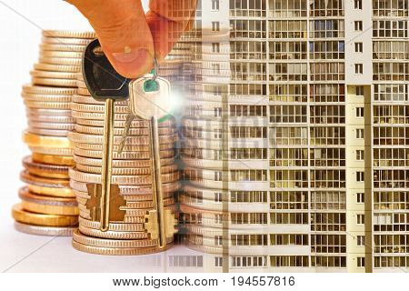 The keys to the apartment on a background of money and houses . The concept of mortgage lending .