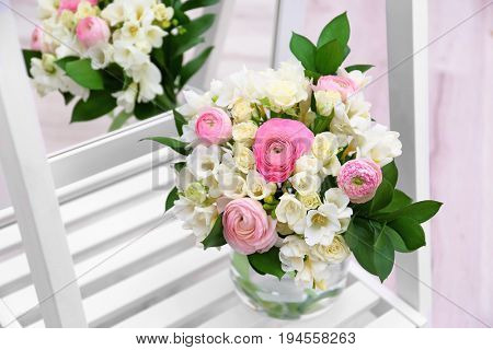 Beautiful bouquet with freesia flowers near mirror