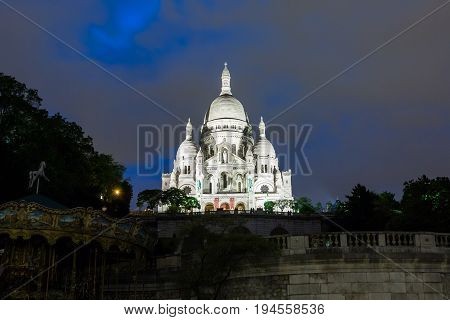 Evening view of Evening view of Basilica Sacre Coeur in Montmartre in Paris France.