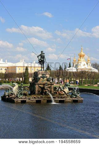 Peterhof, St. Petersburg - May 15, 2010: the Neptune Fountain, The Grand Peterhof Palace, the Square Ponds Fountains, The Royal Church Museum in Peterhof, St.