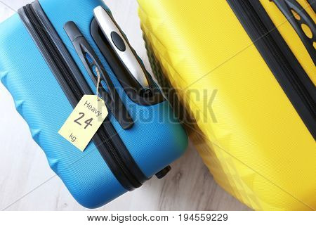 Tag on heavy suitcase. Luggage overweight concept