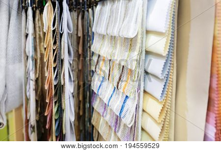 Assortment of beautiful curtain samples in shop
