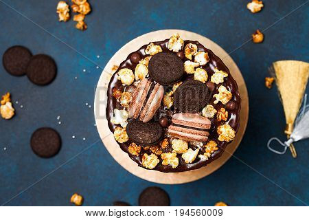 Party cake with macaroons, birthsday concept. Top view, flat lay