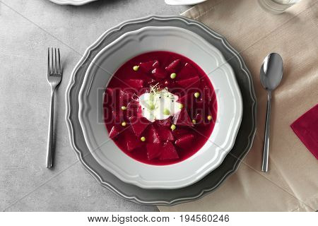 Delicious beet soup with wheat germ and peas on kitchen table