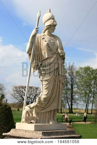Peterhof, St. Petersburg - May 15, 2010: Statue in antique style - Athena Pallada In a helmet  and with a spear   in Peterhof, St. Petersburg