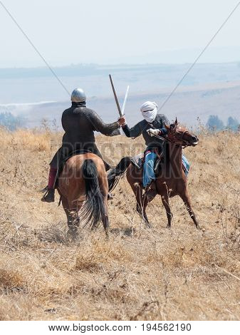 Tiberias Israel July 01 2017 : Participants in the reconstruction of Horns of Hattin battle in 1187 participate in the battle on horseback on the battlefield near Tiberias Israel