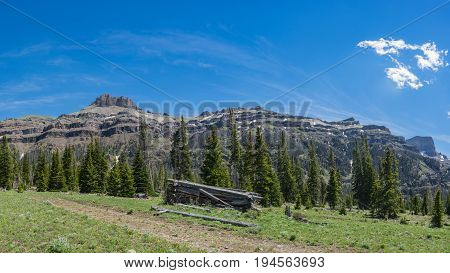 Cabin In Front Of Mountain Range