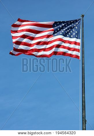 National flag usa with blue sky, vertical