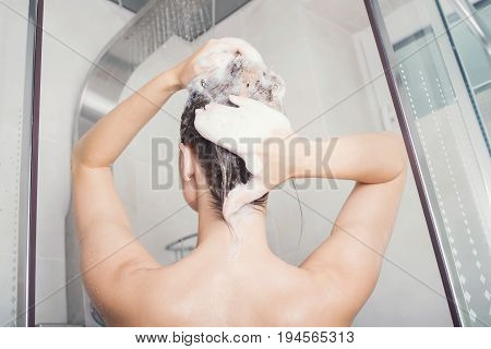 Beautiful Young Woman Is Washing Hair In Bathroom At Home