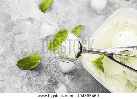 Mint Ice Cream In Spoon On A Gray Background. Top View, Copy Space. Food Background