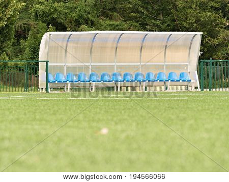 New Blue Plastic Seats On Outdoor Stadium Players Bench, Chairs Under Transparent Plastic Roof