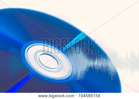 CD compact disc with audio wave for Digital sound optical storage concept.