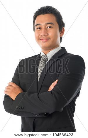 Portrait of arm crossed young Southeast Asian businessman standing isolated on white background.